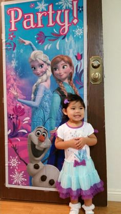 Frozen Party. Store bought door decor for $2 with the birthday girl in her Elsa tutu dress from target for $18. I searched for many party dresses, but this dress was so comfortable so she was able to move and enjoy every second of her party.