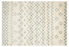 Delicate blue and ivory Moroccan-inspired rug.