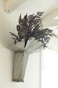 OLD ZINC ELEMENT WITH DRIED LAVENDER ON GUEST HOUSE LIVING ROOM WALL