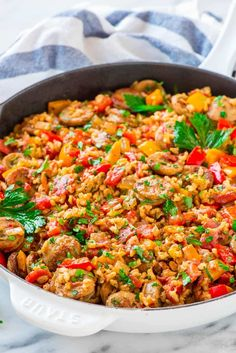 Italian Sausage and Rice Casserole with Peppers. Everyhting cooks in ONE PAN, even the rice! Quick, easy, and healthy. Recipe at wellplated.com   @wellplated