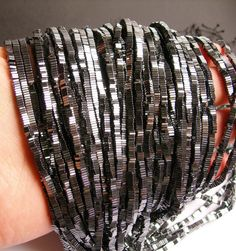Name of gems: Hematite Size of beads : 3mm x 1mm  Shape : square slice - heishi  Length:approx 16.inch - 40cm  Quality :AA  Quantity:1 strand for approx 390 to 400 beads- pcs  Hole: approx 0.9 - 1mm Description:You will receive the same quality has you see in picture.Always--very nice hematite  Condition:new  Packing: Bubble wrap  We answer all convo within a few hour.  For more great gemstone visit our shop fallinlovegems.etsy.com  Thank you  Code:CHG10    For all the hematite we have…