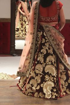 Bridal Lehengas - Velvet Bridal Lehenga with Golden Bird and Floral Embroidery | WedMeGood  #wedmegood #lehenga #indianbride #indianwedding #bridal #velvet #gold