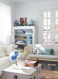 Writer and graphic artist Jessica Graves, of the fashion and style site The Love List, shared these photos of the living room of her Atlanta home. She's captured the classic style of the Southern interiors she's always admired and combined it with the light, beachy feel of Florida, where she grew up, to create a space that's lovely to look upon but still begs you to make yourself at home.