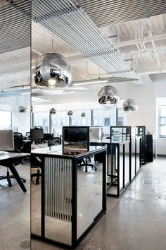 Just because you're in a commercial office space doesn't mean the aesthetic has to be cold and void of style. This NYC office uses many everyday materials to create visual impact AND cohesion throughout a large, open workspace.