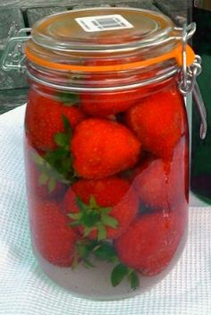 Strawberry-infused Vodka For those who have never infused liquor before, leaving porous substances (i. sliced fruit, meat, etc. Drinks Alcohol Recipes, Alcoholic Drinks, Homemade Christmas Presents, Strawberry Vodka, Cocktail And Mocktail, Alcohol Gifts, Infused Vodka, Holiday Cocktails, Refreshing Drinks