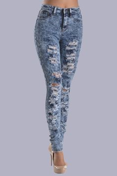 These high-waist body forming skinny jeans are perfect for any and all tees, tanks, sweaters, tunics and more! They are acid wash with destroyed details in the front which gives it a cute worn look! These are one of our most restock items! They sell out fast so be sure to grab yours before they are gone!    Material: 49% Rayon, 32% Cotton, 17% Polyester, 2% Spandex  Color: Blue Mineral Wash  Made in: USA  High waist, ripped details on front  Skinny fit, two front accent pockets, two back…