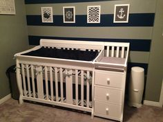 Nautical boys nursery. Navy blue and grey. Striped wall.
