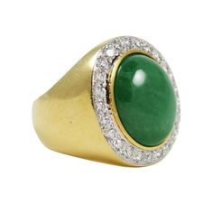 Oval Natural Jadeite Ring set in 18kt Yellow Gold with 25 Full Cut Diamonds. Signed 750/18kt with Unknown Maker's Mark. Closed Back. 1stdibs.com.