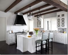 Heather Scott Home Design. Gorgeous beamed ceiling. Glass panels on the upper cabinets are a nice touch. White cabinetry.