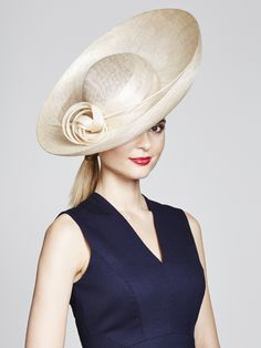 Large sinamay upturn brim with side knot detail and quill. Colour: Natural and…