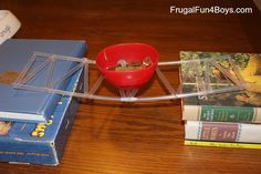Straw and Pin Bridge: Using straws and pins, children can build a bridge. Allow the children to experiement with their bridge designs, place the bridge between to stacks of books, and then test the strength of the bridge by setting small objects on top. Children will explore the physics of architecture and will engage in the scientific process. Ages 4-5.