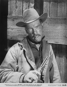 GUN FURY - Lee Marvin as a member of an outlaw gang who kidnaps a newlywed bride (Donna Reed) - Directed by Raoul Walsh - Columbia - Publicity Still. Western Film, Western Movies, Picture Movie, Movie Tv, Lee Marvin, Donna Reed, Tv Westerns, Tough Guy, Steve Mcqueen