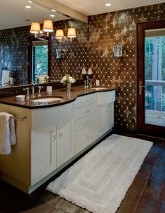 Master Bath- double vanity; curved sink cabinet; beautiful tile detail; porch off of master bath