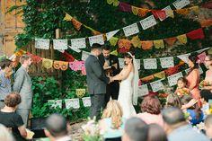 papel picado backdrop // photo by Kate Romenesko, flowers by Pistil & Vine  http://ruffledblog.com/chicago-day-dead-wedding