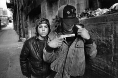 """Mary Ellen Mark (American, born """"Rat"""" and Mike with a Gun, Seattle 1983 Gelatin silver print x cm x 13 in.) © Mary Ellen Mark The J."""