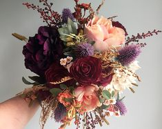 This silk fall wedding bouquet with its rustic detail is perfect for the autumn bride. This handmade bouquet is made with realistic, quality silk flowers and artificial elements. This bridal bouquet is made with burgundy ranunculus, beige and cream h Rustic Bridal Bouquets, Silk Wedding Bouquets, Autumn Wedding Bouquet, Fall Bouquets, Rustic Bouquet, Artificial Wedding Bouquets, Silk Wedding Flowers, Flower Bouquet Wedding, Hydrangea Wedding Bouquets