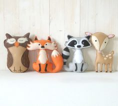 This listing is for four felt woodland forest stuffed animal hand sewing patterns: a fox, a deer, an owl, and a raccoon.