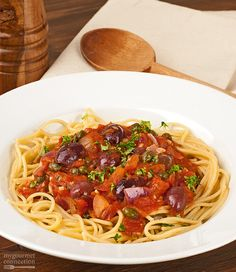 This pungently flavored pasta sauce is made with tomatoes, black olives, capers and anchovies. Serve it with any cut of pasta you choose, add a salad and you have a satisfying, quick and economical dinner.
