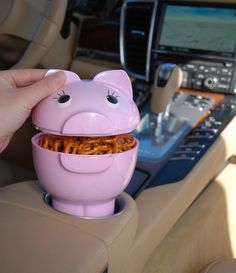 Designed to fit in the cup holder of a car, car seat or stroller, the PigOut Cargo container is the perfect travel bowl. It gives you the freedom to enjoy your favorite snacks while on the move. And,