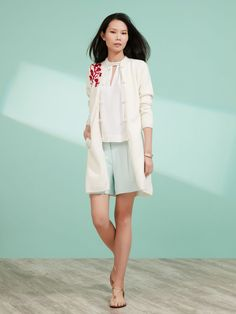 Chinese Blossom embroidery across one shoulder brings a touch of spring romance and eastern elegance to this light wool cardigan in our signature full-length sleeves shape. The white cardigan has red embroidery, and the light blue version has white.   Colour: White, Light Blue Ref: 1RA89Q3