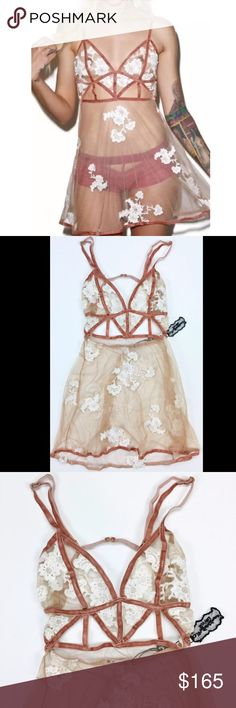 """NWT XS & M For Love and Lemons Floral Nighty Brand New With Tags For Love and Lemons """"Darla"""" Nighty Size: X-Small & Medium Sunning nude mesh see-through nighty with white floral embroidering. Features dark pink velvet bondage style straps throughout the piece. Adjustable shoulder straps and a hook adn eye closure in the back. Retail: $172.00 USD  Material Content: 100% Polyester For Love and Lemons Intimates & Sleepwear"""