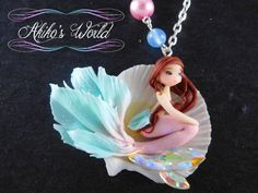 Tiny pink and turquoise mermaid in her seashell by AkikosWorld