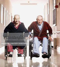 Elderly men racing in wheelchairs - Stock Photos : Masterfile