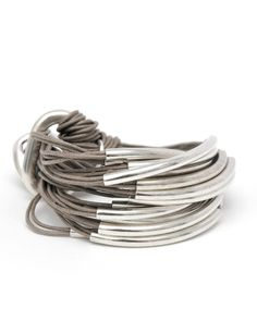 Multitube bracelet taupe by Orit London.