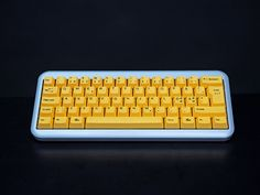 hoz's Ducky Mini YOTH with Ducky yellow keycaps.