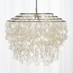 Shop teardrops capiz chandelier.   Grand in scale and statement, iridescent capiz shells seem to glow from within.  Handcrafted by artisans in the Philippines where capiz is abundant, the shells are harvested from local windowpane oysters.