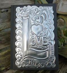 A hand embossed journal with pewter detail on the cover. Ideal Valentine or Wedding gift. Plain pages and hard back. Please contact the seller to personalise this journal for you. Tin Foil Art, Aluminum Foil Art, Aluminum Can Crafts, Aluminum Cans, Metal Crafts, Metal Tape Art, Metal Artwork, Tin Can Art, Tin Art