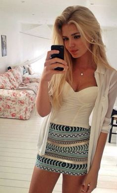 top white dress top white bustier bustier blonde hair model outfit fashionista 20 streetstyle girly dressy strapless top sweet heart neckline top bralette necklace silver black iphone black phone living room selfie tribal pattern skirt blue pencil skirt