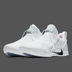 Nike's latest Kobe signature model, the Kobe A. NXT, will release in a brand new white/black colorway next week at Nike Basketball retailers. Featuring a snow white Flyknit upper and matching sole, this upcoming release is just short of reaching … Conti Kobe Shoes, Men's Shoes, Shoe Boots, Shoes Sneakers, Sports Shoes, Basketball Shoes, Tenis Nike Casual, Nike Trainer, Sneaker Store