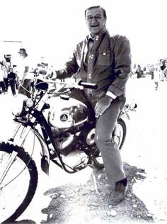 John Wayne loved to ride bikes. Hodaka Wombat on movie set