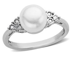 Im completely in love with this pearl ring. I may need to add this to my collection