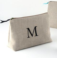 "PersonalizedFinds on Etsy: Cosmetic Bag (large), $24  Monogram: classic ""M"" as displayed Thread color: hot pink"