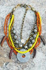 Tribal Orange and Yellow Glass, Wood, and Silver Sun Pendant Necklace