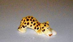 Vintage QuonQuon Leopard or Cheetah Figurine shelf by designfrills