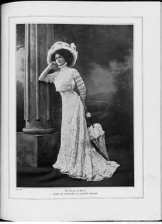 """Dress for the races. This is a wonderful example of how lingerie dresses were accessorized- with matching lingerie parasol, large hair style and even larger straw hat decorated with matching trimmings. It is also interesting to note that to emphasize the model's columnar figure, she is photographed standing next to a Roman type column. Source: Les Modes, A8, N92, August 1908."" http://pinsndls.wordpress.com/"