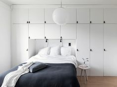 Fresh home with a smart bedroom storage solution - via Coco Lapine Design blog