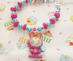 Bead and button bunny bracelet  pink and blue by NiNEFRUiTSPiE, £3.50