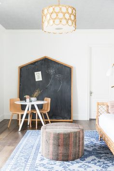 Fun and bright kids playroom. Eclectic and colorful playroom design. #chalkboard | Studio McGee Blog