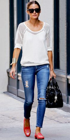 Olivia Palermo styled her mesh sweater and distressed AG Jeans with a statement cuff, Westward Leaning shades, a handbag with scaly detailing and embroidered coral loafer slippers.