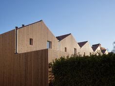 French firm Odile Guzy Architectes has completed a social housing project in Chalon-sur-Saône with slatted timber facades that form solar screens.