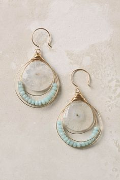 I see these paired with something coral, a scarf, a dress, or a clean crisp shirt. Definitely beach earrings.