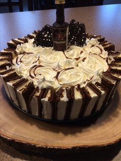 Ice Cream Cake!  (Oreo Cookie Base, Ice Cream Sandwiches & Homemade Peanut Butter Ice Cream)  Topped with an edible Chocolate made - Captain Morgan Bottle with Rum inside.  Enjoy!