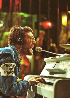 """John Lennon singing """"Instant Karma (We All Shine On)"""", 1970"""