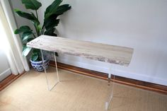 Beautiful Spalted Maple console with lucite base. Wood is sanded and finished with lacquer to resist staining and water damage. Wood slab is 1.5