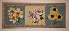 A lovely Elizabeth Bradley Blooms needlepoint wall hanging with a rope border!
