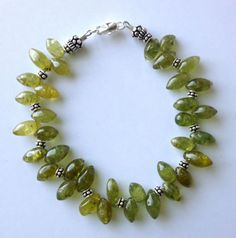 "Eye-catching and handcrafted 7.5"" inch long bracelet with lush, deep green, green garnet drop beads and .925 sterling silver spacer and accent beads. */mg*/"